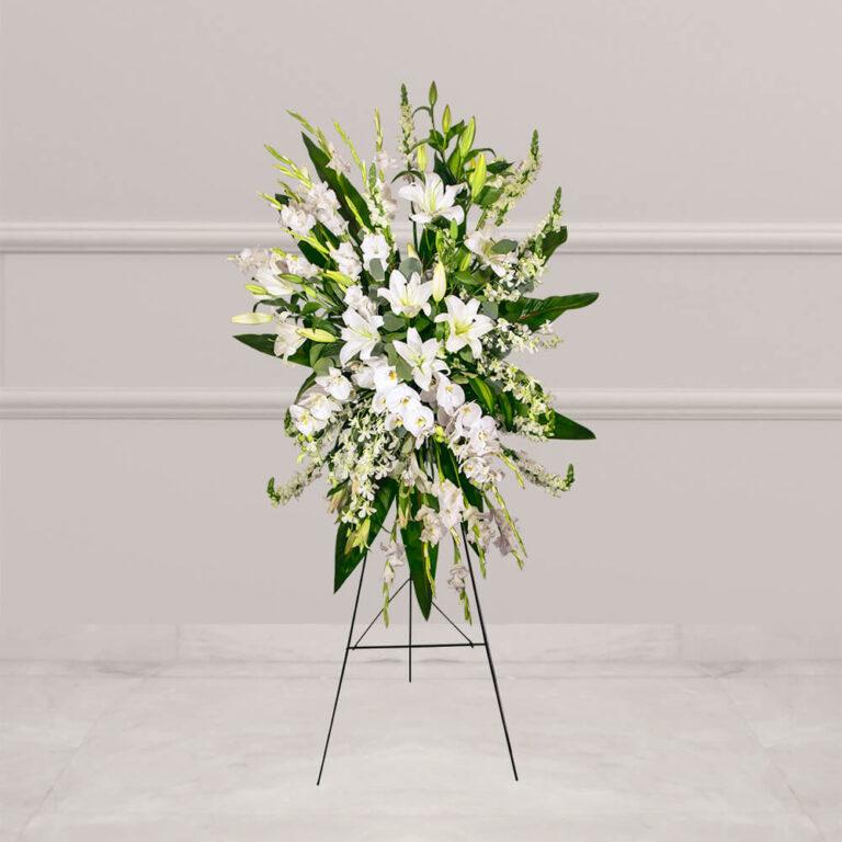 Arreglo floral natural para funerales con gladiola, casablanca y orquideas
