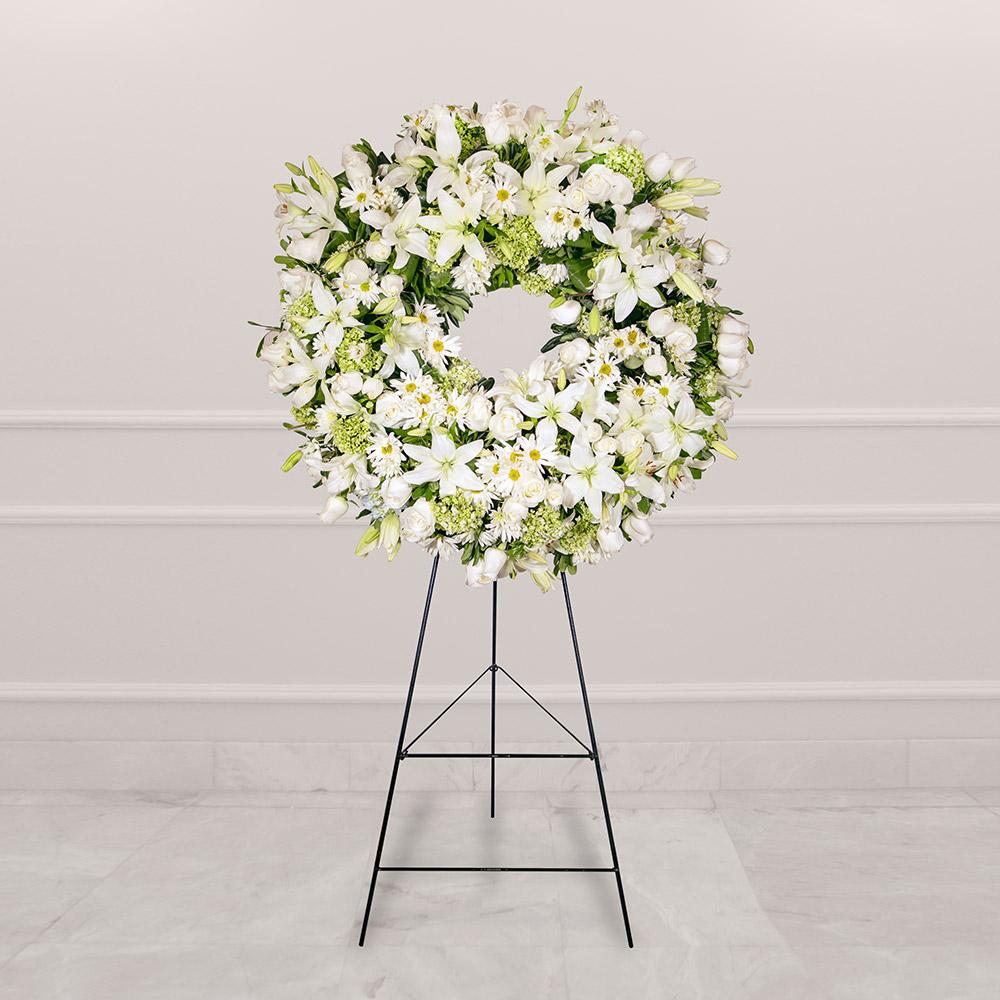 Corona fúnebre con rosa y margaritas